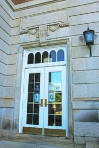 McDonough door with COVID signs